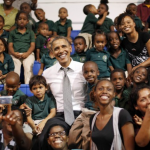 "Photo of the Day: President Obama Gets ""Photo Bombed"" by Kids"
