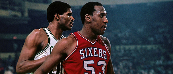BOSTON - APRIL 29:  Darryl Dawkins #53 of the Philadelphia 76ers posts up against Robert Parish #00 of the Boston Celtics in Game Five of the Eastern Conference Finals during the 1981 NBA Playoffs at the Boston Garden on April 29, 1981 in Boston, Massachusetts.  The Boston Celtics defeated the Philadelphia 76ers 111-109 and won the series 4-3. NOTE TO USER: User expressly acknowledges and agrees that, by downloading and or using this photograph, User is consenting to the terms and conditions of the Getty Images License Agreement. Mandatory Copyright Notice: Copyright 1981 NBAE (Photo by Dick Raphael/NBAE via Getty Images)